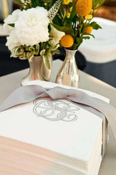 Monogrammed paper hand towels wrapped in grosgrain ribbon for bathroom