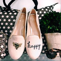 happy shoes with a bee
