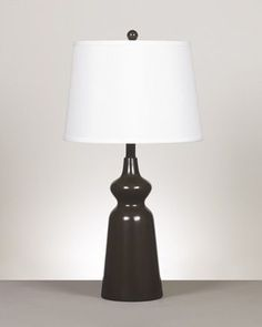 Olicia Metal Table Lamp  $59.99 Sku:102515 Dimensions:14Wx14Dx27.75H The Olicia metal table lamp is simple yet elegant which is all you need to make the perfect fashion statement! Please visit our website for more information.