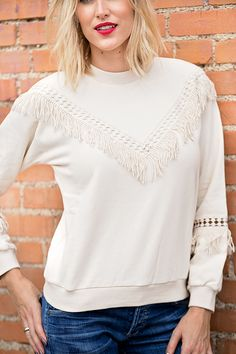 Instead of just wearing a casual sweatshirt, look for dressy sweatshirts for a comfortable look that's still pulled together! This fringe sweatshirt is a perfect closet staple because it looks amazing paired with jeans for a no-fuss look. Click through for more details on this look and to shop this exact sweatshirt.