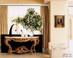 Jeffrey Bilhuber ~ The foyer of a Manhattan duplex has an antique gilt console and a Harvey Probber chair.