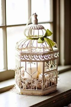 Shabby chic decoration - bird cage and candles - The bird cage is equally a property for the chickens and a pretty tool. You can pick whatever you want one of the bird cage models and get much more unique images.