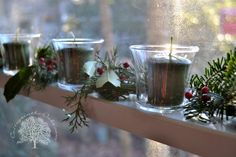 Votives and Greenery in Windows for Christmas