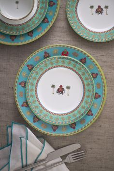 INDUS DINNER SERVICE  'Indus' is an extension of our iconic 'Periyar' design story that is inspired by the magical lake in Kerala. Reflected in the blue waters of the lake are verdant groves of palms, banana and mango trees. Majestic elephants dressed in their finery with howdahs are an integral part of the landscape. Hand-decorated fine bone china with 24-carat gold accents. Discover our Indus collection on our #WebBoutique  #EntertainInStyle #DesignStory #BackInStock