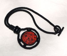Bellatrix ... Necklace . Statement . Bold . Black . Red . Artisan . Polymer Clay Focal . Bead Crochet Rope . Unique . Abstract. $139.00, via Etsy.
