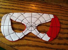 "Make a Spider-Man mask. Use 13"" elastic. Two pieces of felt, sew web on one piece right through template paper, then tear off paper. Sew 1/4 "" around eyes and perimeter of mask."