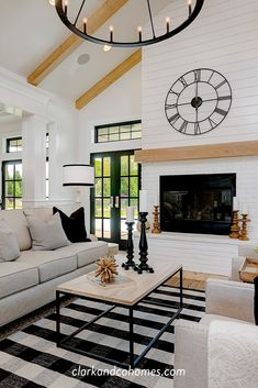 The great room in this Modern Farmhouse home features a custom painted brick and shiplap fireplace with a wood stained mantle that coordinates with the natural wood beams of the vaulted ceiling. home accent Shiplap Ceiling, Shiplap Fireplace, Farmhouse Fireplace, Fireplace Remodel, Fireplace Windows, Two Sided Fireplace, Painted Brick Fireplaces, Living Room With Fireplace, Living Room Grey