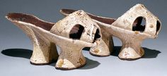 Venetian chopines Beige leather. decorated with stamped and pierced designs and small pompoms of silk floss. Metropolitan Museum of Art
