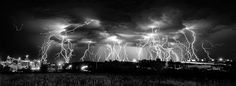 The Reckoning, by Tom Warner. Lightning approaches Rapid City, South Dakota on the night of 19 July 2013. A 5.7 min composite exposure consisting of 18 individual 20 sec exposures.