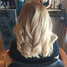 Light blonde balayage with curls