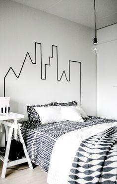 Graphic + black washi tape skyline, could do this with a tree line