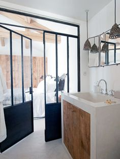 love this: the door/glass wall, the sink, the lighting, and the palette..................