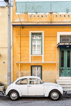 Vintage VW Beetle in Athens, Greece with a yellow house as a backdrop. #athens #greece #vwbeetle #vintagecar #europe