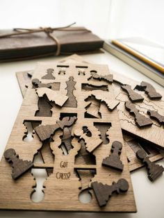 Got Chess? Laser cut wood pieces in pop-out frames