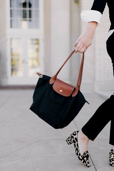 540acd1f52e8 Women s black bag. For many ladies