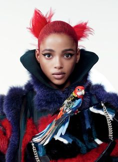 vogue:  It's time to ruffle some feathers.The chicest coats and accessories of season come feathered and furred.