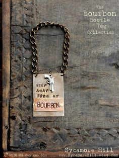 The  Bourbon Bottle Tag Collection  The Riveted Series  Layered Metal Tag Riveted Brass and Copper Metals by Sycamore Hill, $42.00  Stock the Bar Man Cave