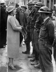 Queen Elizabeth speaking with air raid rescuers, some of the most unsung heroes of the war, in south London, September 1940