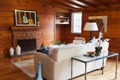 Contrast while leaving the original pine walls. Real Estate Report: Almost Un-Renovated in Parkside, With Knotty Pine Knotty Pine Living Room, Knotty Pine Rooms, Knotty Pine Decor, Knotty Pine Paneling, Living Room Decor, Living Spaces, Living Rooms, Wood Paneling Decor, Beadboard Wainscoting