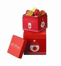 Boîtes rouges, Jeff de Bruges - Cadeaux de Noël en urgence - De sympathiques petites boîtes rouges qui nous font revenir en enfance en un clin d'œil... Pièces en chocolat, confiseries et autres gourmandises raviront les plus petits comme les grands...