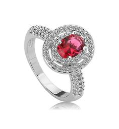 *Free shipping worldwide* Luxuriously stylish in every way, this elegant silver tone synthetic ruby ring is surrounded by a double halo of pavé-set cubic zirconia. | bridal ring | wedding ring | bridesmaid ring | prom ring | silver ring | ruby red ring | bridal jewelry | wedding jewelry | prom jewelry | bridal jewellery | wedding jewellery | prom jewellery