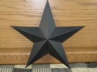 This 12 in. Black Barn Star would be a fun way to finish off decorating a room or even a covered porch.  http://www.primitivestarquiltshop.com/12-in-Black-Barn-Star_p_6402.html  $7.95