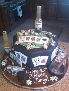 poker cake - This cake was covered in fondant, sugar beer bottles, gun, ashtray, cigars, poker chips, cards, bottle opener and money is gum paste....playing cards and money are edible images on rice paper