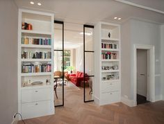 "pocket doors that are glass so that the light can come through with floor to ceiling storage on either side that separates ""entry"" from library nook"