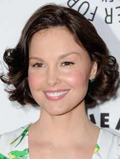 Chin-length: Ashley Judd  To keep a short, simple style from veering into mom-hair territory, use a hot roller in the front section to create lift, then keep it movable but kempt with a flexible-hold hair spray. Finally, get glossy with a shine spray. Done and done.