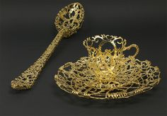 Artist Wiebke Maurer is drawn to objects found in traditional place settings like spoons, bowls, saucers, and tea cups, but her interpretation of these pieces leaves function behind, resulting in delicate sculptures that fuse the past and present. Working primarily with gold and silver the pieces se