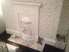 Old fireplace painted with home made chalk paint