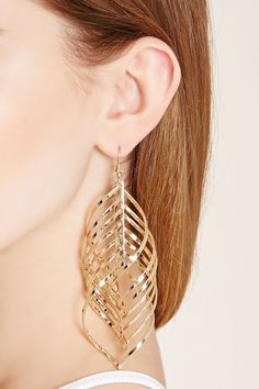 A pair of high-polish heavyweight drop earrings with an oversized spiral cutout design and fish-hook backs.
