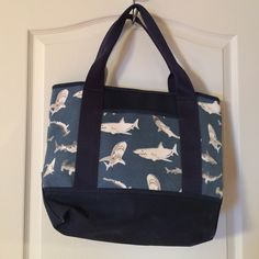 Canvas Blue Shark Tote Blue with grey sharks, pottery barn kids, large outside pocket, large inside zip pocket, great condition, stored more than used, approx 14x14x 5 Pottery Barn Kids Bags Totes
