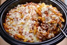 A recipe for easy crockpot baked ziti with minimal prep work. This recipe is vegetarian and takes no time at all to put together!