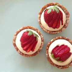 Raw Orange Vanilla Cream Tarts topped with Fresh Strawberries