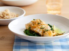 Food Network invites you to try this Thai-Style Halibut with Coconut-Curry Broth recipe from Ellie Krieger.