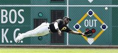 Pittsburgh Pirates right fielder Josh Harrison is unable to make the diving catch on an RBI double hit by Miami Marlins' Giancarlo Stanton during the first inning of the baseball game on Thursday, Aug. 8, 2013, in Pittsburgh. (AP Photo/Keith Srakocic)