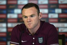 Wayne Rooney of England talks to the media during a press conference at Celtic Park Stadium on November 17, 2014 in Glasgow, Scotland