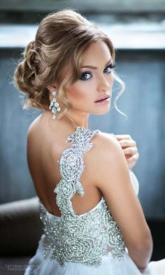 Romantic updo wedding hairstyle - medium hair, elegant. See more: http://www.weddingforward.com/romantic-bridal-updos-wedding-hairstyles/ #weddinghairstyles #bridalhairstyles #UpdosRomantic