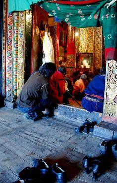 Gathering for morning prayer Tibet