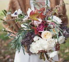 Fall wedding bouquets   Fall floral inspiration   100 Layer Cake I kind of love how wild this is with the olive, but I want to use more Magnolia leaves.