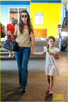 Katie Holmes picks up her daughter Suri from gym class on July 15, 2013