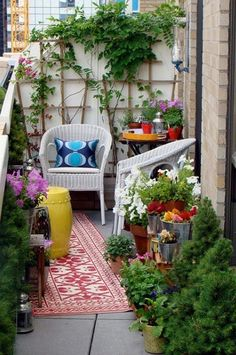 Twin Wicker Chairs on a tiny balcony