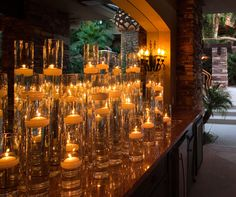 The light from countless hurricanes with floating candles is dramatized by a large wall mirror.