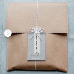 Cute idea bag/envelope from brown paper stitched in another color.  Nice wrap.