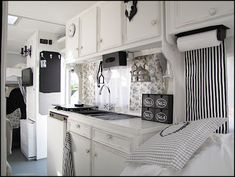 {shabby chic motor home in Germany...so beautiful! All that white would never stay so pristine with our crew, though :P }