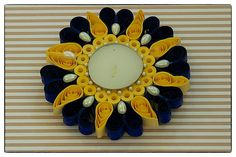 Pearly floral -This collection is inspired by nature!! Our choice of color, embellishment & design is pre dominantly Indian.These water resistant quilled candle holders are great option They make good decorative item or you can just pick them for gifting..Each one is handmade by using paper strips, quilled to get desired designs.  www.facebook.com/craftstruck  craftstruck2012@gmail.com  #quilledart #quilling #quilledcandles #quilledtealightcandle #craftstruckdesignstudio #quilledhomedecor