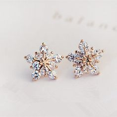 Twinkling Star Earrings Maybe snowflakes? If only it was done in white gold or silver.