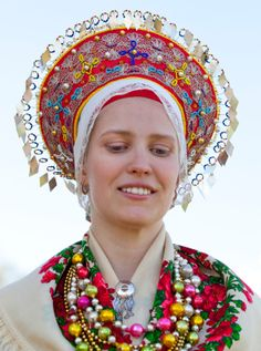 "At a time when folk costumes was used in rural areas all over Scandinavia and before the bridal crown came in use, a headdress named ""Lad"" crowned the bride on her wedding day. The Lad is still used in traditional weddings both in Sweden and Norway and is found in a varity of different shapes with colourful decorations."
