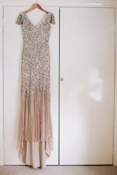 Sophie wears a gold, sequin Phase Eight gown for her wedding at The Norfolk Mead Hotel, an elegant Georgian boutique hotel in the heart of Norfolk. Photography by Joanna Millington.